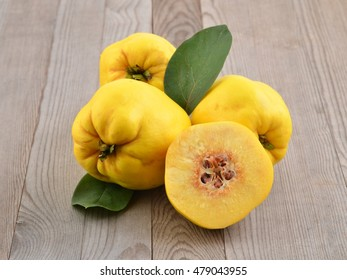 Quince on wood background. Autumn fruits.