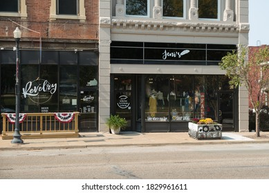 Quincy, IL / United States of America - October 8th, 2020 : Storefront view of Revelry and Jeni's in downtown Quincy, IL across from Washington Park.  Local business exteriors.