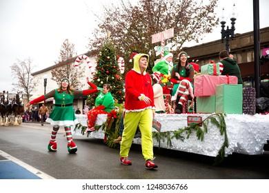 QUINCY, MA USA - NOVEMBER 25 2018: Christmas parade. the elves of Santa Claus in a car. Boston, Massachusetts, USA