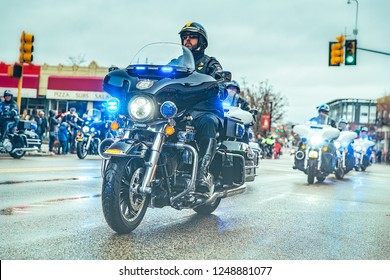 QUINCY, MA USA - NOVEMBER 25 2018: Police on motorcycles riding down the street during Christmas Parade in Boston, MA. Christmas parade. Boston, Massachusetts, USA