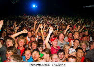 QUINCY, WA - JULY 27, 2006: Crowd jumping and cheering during a performance by the band Kutless at Creation NW, a 4 day Christian concert festival at the Gorge Ampitheater in Washington.
