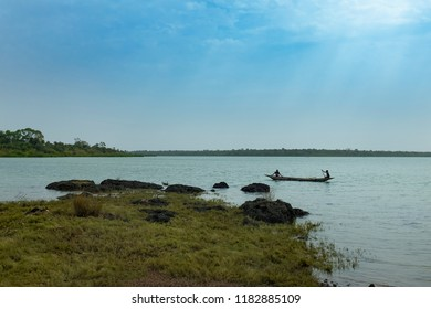 Quinhamel, Republic of Guinea-Bissau - February 2, 2018: Two young fisherman in a traditional fishin canoe near the village of Quinhamel in Guinea-Bissau.