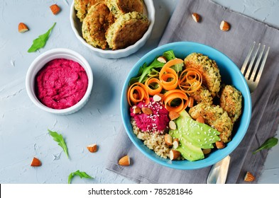 Quinoa Beet Hummus Falafel Bowl on a stone background. toning. selective focus