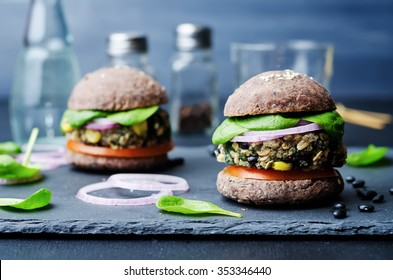 quinoa black bean spinach corn burgers with black beans bun crust. toning. selective Focus
