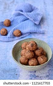 Quinoa chocolate raisin oat protein energy balls