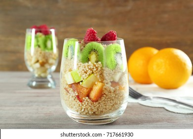 Quinoa and fruits in glass on table
