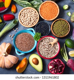 Quinoa, mung beans, seed flex, red, black lentils, chickpeas, healthy vegan cooking ingredients, fresh vegetables und legumes, clean eating concept, square image