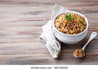 Quinoa with mushrooms and vegetables, selective focus