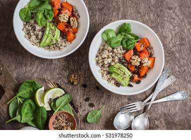 Quinoa and pumpkin bowl. Vegetarian, healthy, diet food concept. On a wooden table, top view. Flat lay