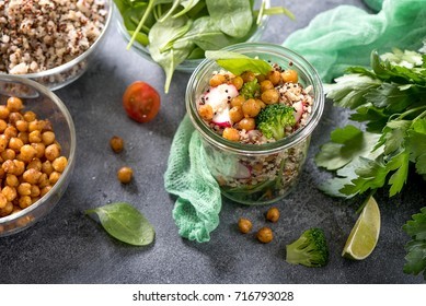 Quinoa salad with baked chickpeas, spinach, avocado and veggies, healthy vegan food, dieting, clean eating, vitamin and protein snack
