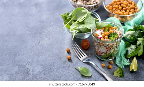 Quinoa salad with chickpeas, spinach, avocado and veggies, healthy vegan food, dieting, clean eating, vitamin and protein snack copy space