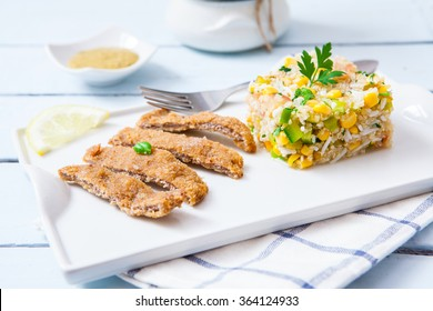 Quinoa salad with deep fried breaded vegan fillet made of tofu