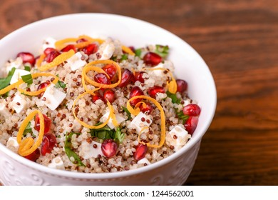 Quinoa salad with feta cheese and pomegranate seeds. Superfoods concept.