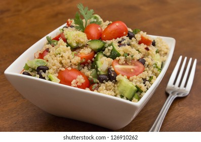 Quinoa salad with fresh vegetables and black beans