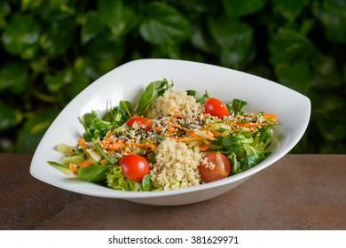 Quinoa salad on a wooden board