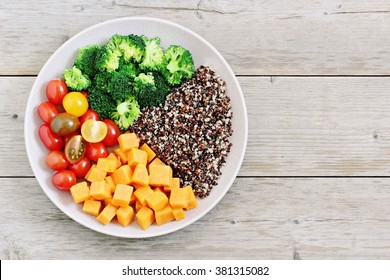 Quinoa salad with sweet potatoes,broccoli and tomatoes ingredients .Superfoods concept.Healthy eating.