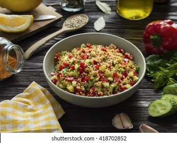 quinoa salad with vegetables for lunch on wooden table