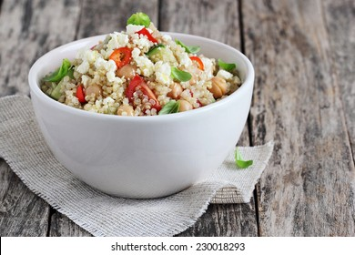 Quinoa salad with vegetables mix, chickpea and cheese. Healthy eating and superfood concept.