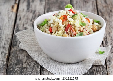 Quinoa salad with vegetables mix, chickpea and cheese.Superfoods concept.
