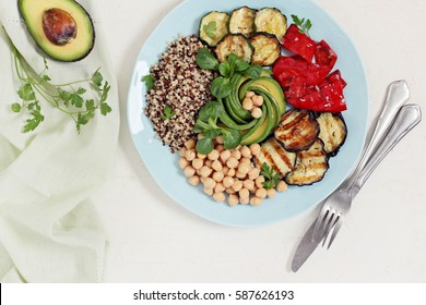 Quinoa salad.Buddah bowl with quinoa,chick pea,avocado and grilled vegetables.Super food and clean eating concept.