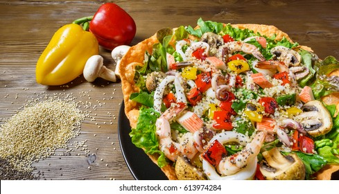 Quinoa Seafood Salad, Mix seafood on a bed of fresh lettuce salad, roasted pepper and mushroom, with sweet chili dressing
