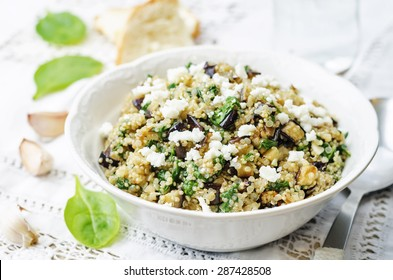 quinoa spinach eggplant feta salad on a white background. the toning. selective focus
