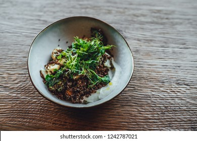 Quinoa Stew in bowl on wooden table