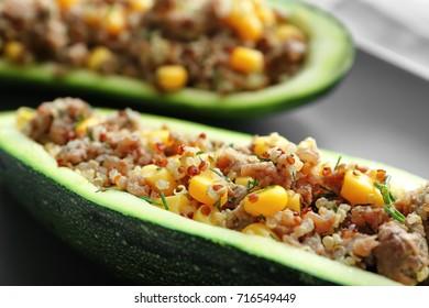 Quinoa stuffed zucchini on plate, closeup