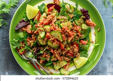 Quinoa tabbouleh salad with tomatoes, cucumber green onion. Concept healthy food
