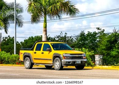 Quintana Roo, Mexico - May 16, 2017: Yellow pickup truck Chevrolet Colorado at the interurban road.