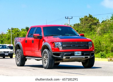 QUINTANA ROO, MEXICO - MAY 16, 2017: Red american pickup car Ford F150 Raptor at the interurban road.