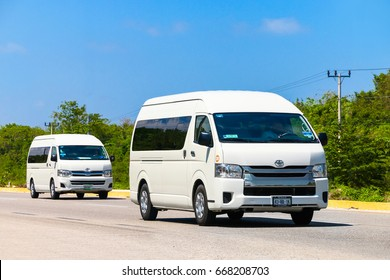 QUINTANA ROO, MEXICO - MAY 16, 2017: Passenger vans Toyota HiAce at the interurban road.