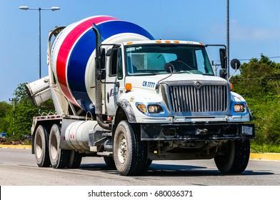 QUINTANA ROO, MEXICO - MAY 16, 2017: Concrete mixer truck International 7600 at the interurban freeway.