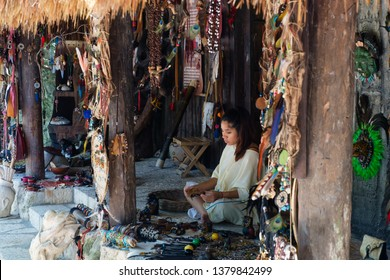 QUINTANA ROO,MEXICO - April 15,2019 : Beautiful young girl making handicrafts at a local mayan community