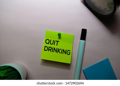 Quit Drinking text on sticky notes isolated on office desk