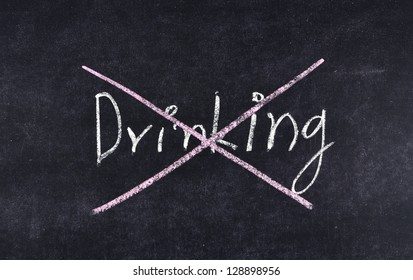 quit drinking written on blackboard
