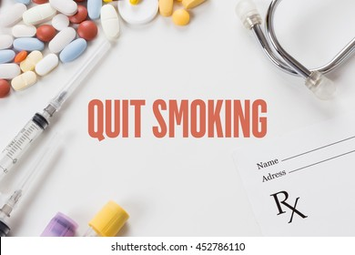 QUIT SMOKING written on white background with medication