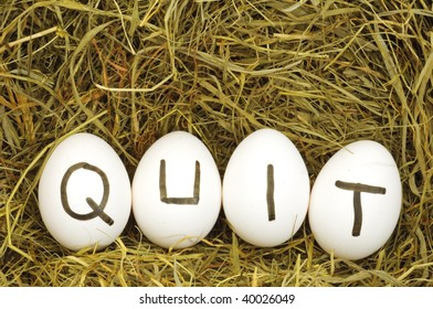 quit written on eggs in hey or straw