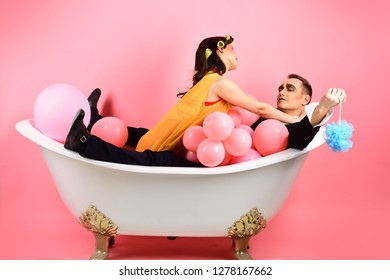 Quite relaxing. Couple in love in bath tub. Bubble bath day. Beauty routine and personal hygiene. Hair grooming routine. Couple of mime man and sexy woman enjoy bathing. Bathing hygiene habits.