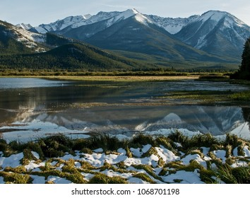 Quite Rocky Mountain spring or fall scene with snow in foreground as well as on the mountain tops