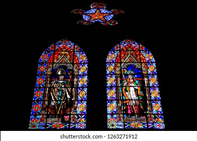 """Quito, capital city of Ecuador - April 16th, 2017: colorful stained glass window of the catholic church """"Basilica del Voto Nacional"""", one of the most famous religious sites in Ecuador"""