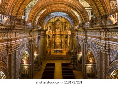 Quito. Ecuador. 04.01.08 Interior of La Compania Jesuit Church in Quito, Ecuador, South America. Much of the ornate interior is made from local volcanic pumice which has then been covered in gold leaf