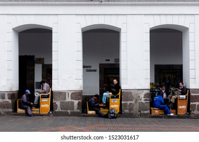 Quito, Ecuador, 1 4 2016: Three shoeshine stand are seen in the main square of Quito