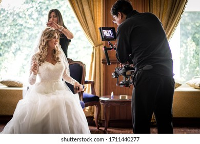 Quito - Ecuador 10-10-2019: Filmmakers at a wedding working with the bride