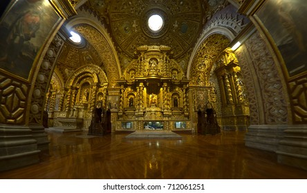 QUITO, ECUADOR - 2017: The Church of the Society of Jesus (Compañía de Jesús) is a Jesuit church in baroque style,  profusely decorated with gold leaf, gilded plaster and wood carvings.
