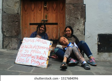 Quito, Ecuador - 28-9-2019: Venezuelan family flying from the crisis and now begging for work and money on the streets