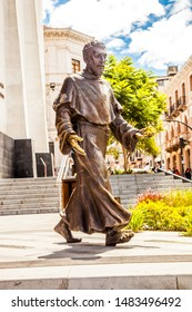 QUITO, ECUADOR - 8 AUGUST 2019: Bronze sculpture with the figure of a priest walking, exposed in the streets of the historic center of the city of Quito in Ecuador.