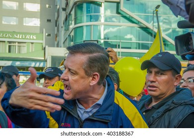 Quito, Ecuador - April 7, 2016: Closeup opposition leader Andres Paez surrounded by people, police and journalists during anti government protests in Shyris Avenue