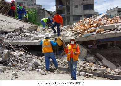 Quito, Ecuador - April,17, 2016: House destroyed by Earthquake with rescuers and heavy machinery in the south part of the city