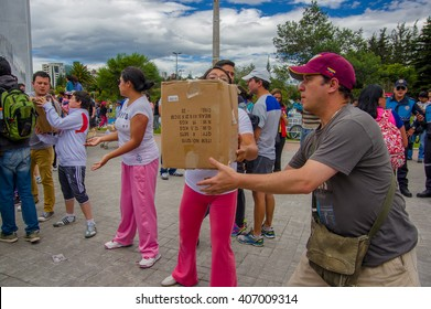 Quito, Ecuador - April,17, 2016: Unidentified citizens of Quito providing disaster relief food, clothes, medicine and water for earthquake survivors in the coast